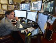 Dan Kaufman, president and CEO of Reagan Wireless, at his desk.