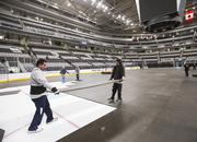 Revealing the ice. Workers move the panels that protect the ice during the concert.