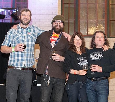 The Barley John's Brew Pub team celebrates its Great Snowshoe Award at Winterfest Friday at the Union Depot in St. Paul. From left: Cook Brandon Waters, head brewer JT Dalton,  and owners Laura Subak and John Moore accepted the award.