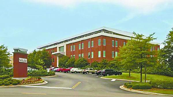 Baptist Health System relocated its headquarters to this building near Five Points South. it recently sold its former Lakeview headquarters to Sloss Real Estate.