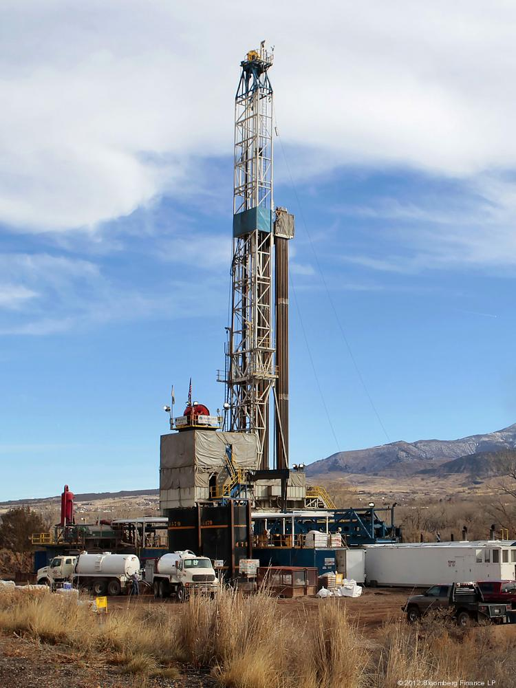 A Nabors Drilling USA LP rig drills for natural gas in a field west of Rifle. Photographer: George Frey/Bloomberg