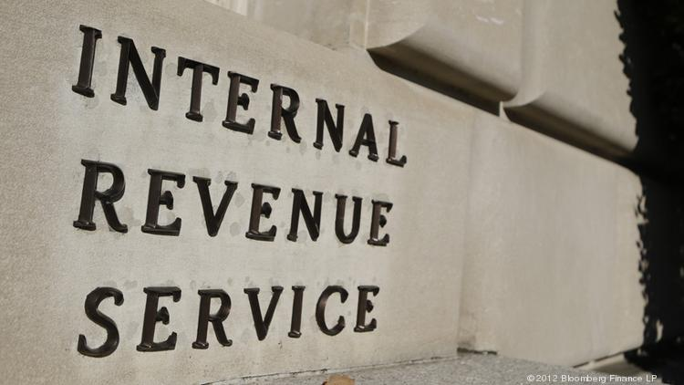 Inspector general's audit found that the IRS paid more than $1 million in performance bonuses to employees who owed back taxes.