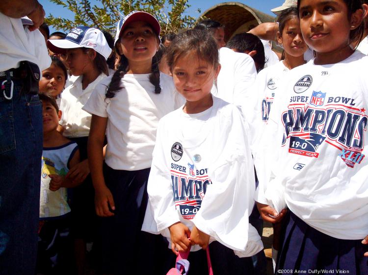 World Vision distributed NFL Super Bowl XLII New England Patriots T-shirts outside of Managua, Nicaragua, in 2008.