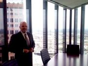 "Munsch Hardt CEO Phil Appenzeller stands next to the conference table in ""The Point,"" the firms premier conference room on the 27th floor of Pennzoil Place. Appenzeller hopes the firm's aggressive expansion strategy in Houston -- and the view -- will help him poach local talent."