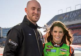 Kyle Mauch, the Scottsdale CEO and founder of Athletes Brand. He's pictured with GoDaddy spokeswoman Danica Patrick.