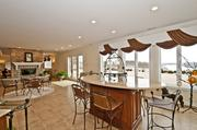 The finished basement has a full kitchen and a dual-sided fireplace, with a walkout to the back patio.