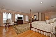The master bedroom also shows off the home's impressive river views.