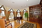 The study, which is being used as a piano room, has custom built-ins.
