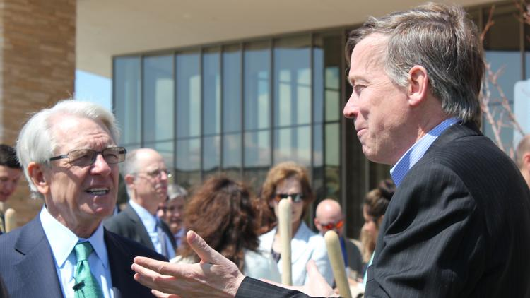 Charles Schwab talks with Colorado Gov. John Hickenlooper during a groundbreaking event in 2013 for firm's new campus in Lone Tree. The Colorado Office of Economic Development and International Trade played a major role in landing that expansion.