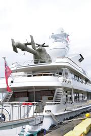 Paul Allen's yacht, Meduce, seen in port at Honolulu Harbor, has a helicopter on deck.