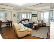 The family room in a 14th floor unit at Rowes Wharf on Boston's waterfront.
