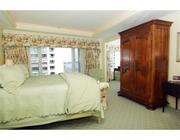 Master bedroom with city and harbor views at 10 Rowes Wharf.