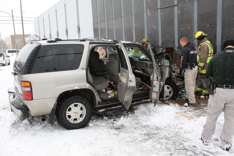 Emergency workers respond to the scene of a crash involving an SUV that ran into the USD 490 El Dorado administration building.