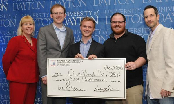 (Left to right) Competition coordinator Diane Sullivan; team members Michael Reuther, Jordan Schneider and Allen Ralph; mentor Carmine Gentile. OurVinyl.TV has won the $25,000 University of Dayton Business Plan Competition.