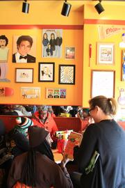 What color other than warm mustard yellow would cover the walls at Dirty Frank's?