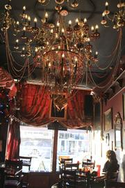 A dramatic chandelier hovers over the front portion of Surly Girl.