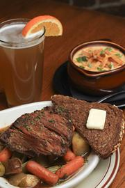 Tip Top's pot roast with a side of corn chowder and German beer.