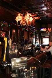 Part of the Tip Top's charm comes via a tin ceiling, chandeliers and long wooden bar.