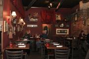Tip Top's walls are deep red and lined with old photos, strange knick knacks and gilded lamps and draperies.
