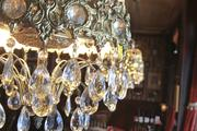 Chandeliers, including this one at the Jury Room, are in all of Lessner's properties.