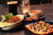 Black garlic and furikake chicken wings, flatbread topped with frizzled Brussels sprouts and charred ham, smoked Gouda cheese, mozzarella and stone-ground mustard sauce, and tomato soup with a hearty beer at the Torpedo Room.