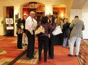 About 175 businesspeople packed the Q Bar at Hotel Albuquerque Tuesday evening for the 1st Tuesdays networking event.