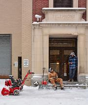 A clean up crew takes a breather from clearing snow in Schenectady.