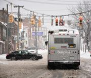 Traffic along State Street in Schenectady was slow going for much of the day after Wednesday's storm.