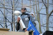 Seahawks wide receiver Doug Baldwin holds a replica of the Lombardi Trophy as he rides in the Seahawks championship parade through downtown Seattle on Wednesday.