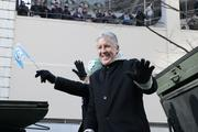 Seahawks coach Pete Carroll waves to throngs of ecstatic fans as he rides in the Seattle Seahawks championship parade through downtown Seattle on Wednesday.