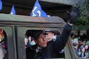 Peter McLoughlin, president and CEO of Vulcan Sports and Entertainment, waves to the crowd as he rides in the Seattle Seahawks championship parade through downtown Seattle on Wednesday. He is responsible for the Seahawks' finance and business operations.