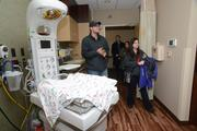 Alex and Ashley Gallup of Albertville tour a birthing room.