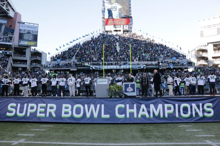 The Seattle Seahawks players and coaches are presented to a crowd at CenturyLink Field after the championship victory parade in Seattle on Wednesday. The city was crowded with an estimated 700,000 plus those at the stadiums, and transit agencies anticipated some delays in getting out of the city.