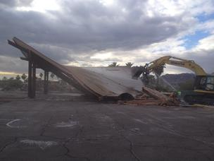 Demolition takes place Feb. 5, 2014 of what was the Mountain Shadows Resort in Paradise Valley. Here, the porte-cochère comes down. It was the roofed structure covering the driveway at the entrance to the lobby.