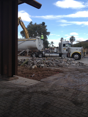 A truck prepares to haul away the rubble.