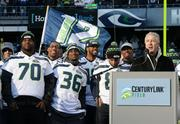 Head coach Pete Carroll, speaks to the fans at CenturyLink stadium to celebrate the Seahawks Super Bowl victory.