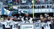 Richard Sherman speaks to the fans at CenturyLink stadium to celebrate the Seahawks Super Bowl victory.