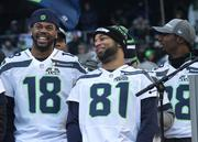 Seahawks players Sidney Rice (18)  and Golden Tate (81) take in the cheering fans at CenturyLink stadium to celebrate the Seahawks Super Bowl victory.
