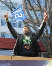 Seahawks players wave to the crowd. Seattle police early on estimated that more than 700,000 people turned out of the Seahawks Super Bowl victory parade on 4th Avenue in downtown Seattle.