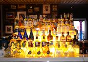 "Lighted tequila display says, ""Drink me now."""