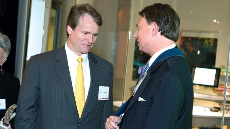 During a reception honoring Bank of America's Neighborhood Builders in Charlotte, CEO Brian Moynihan announced a $5 million donation to Foundation For The Carolinas to support restoration of the Carolina Theatre. Pictured are Moynihan and Foundation CEO Michael Marsicano.