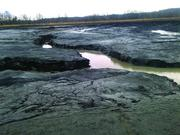 Pictured here is the coal ash basin at Duke Energy's (NYSE:DUK) Dan River Steam Station, where a broken stormwater pipe this week caused the material to spill into the river.