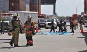 The staging area shows a decontamination tent before it is inflated.