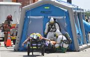 A victim is transfered to the decontamination tent.