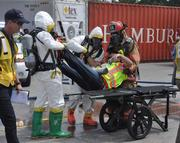 A victim being moved to a stretcher after being brought out of the hot zone.