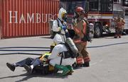 A victim being examined after being brought out of the hot zone.
