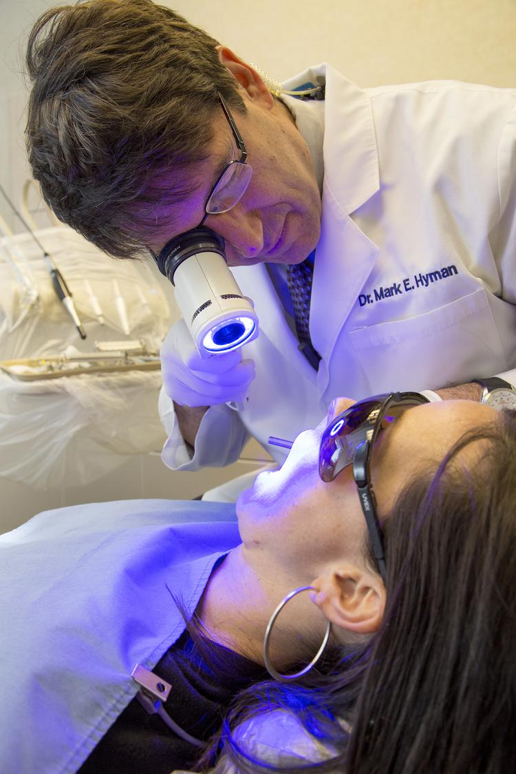 Mark Hyman, DDS uses VELscope to screen for oral cancer.