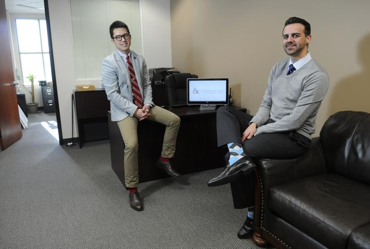 Peter Kyung, left, and Trevor Carson formed their law partnership almost three years ago. They credit constant communication with their continued success.