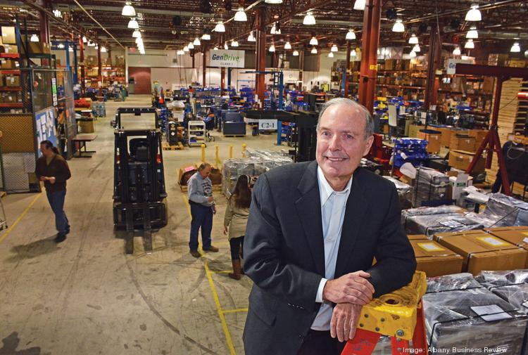 Andy Marsh, president and CEO of Plug Power Inc., on the shop floor in Latham, NY. The forklift at left is one of about 4,500 powered by the hydrogen fuel-cell systems that Plug Power makes. The company employs 150 people.