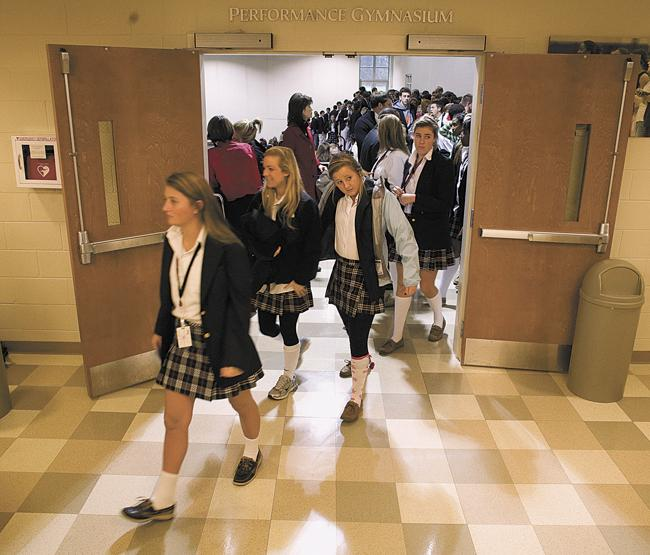 Students leave the annual All-School Holiday Assembly at Ensworth High School on Friday, December 18, 2009.